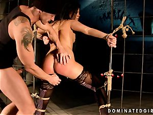 Dark haired doll gets roped and culo drilled by a cracking weenie