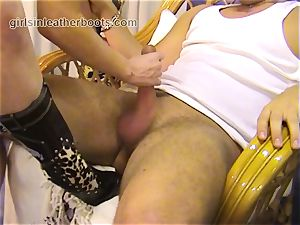red-haired dominates victim with leather footwear bj play
