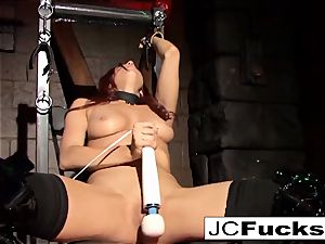 tied beauty pleases herself while still shackled up
