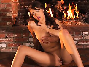 Cassidy Banks playthings her cooch by the fireside
