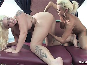 Leya gives Nikita a rubdown that leads to more