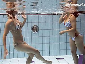 Iva and Paulinka immense fun bags teenis in the pool