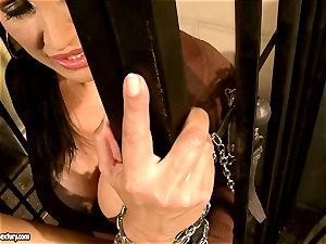 Mandy Bright fettered a steamy stunner at the jail steel